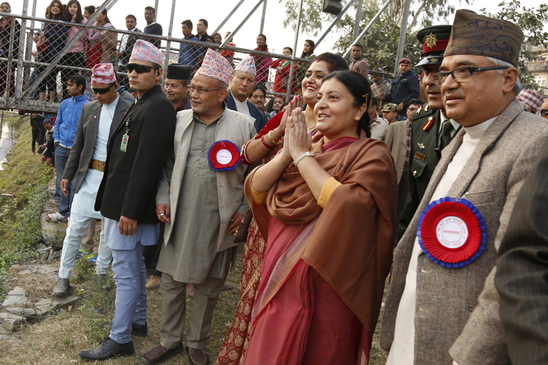 President Bidya Devi Bhandari greets to people after offering prayers to the Sun God, while celebrating the Chhath festival, at Guhyeshwori of Kathmandu, on Tuesday, November 17, 2015. Photo: RSS