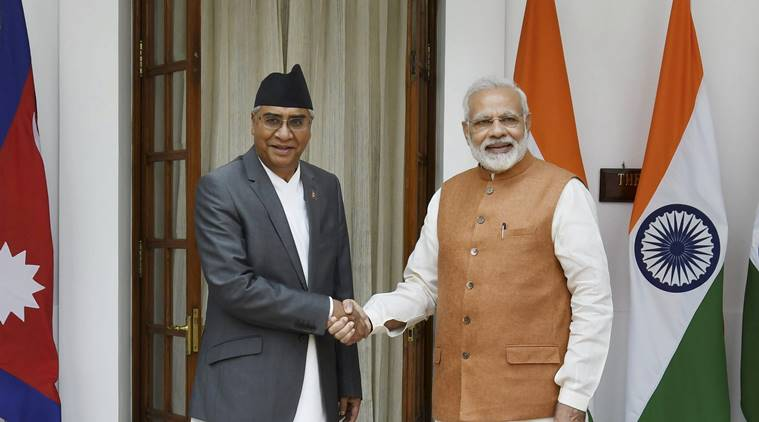 New Delhi : Prime Minister Narendra Modi greets his Nepalese counterpart Sher Bahadur Deuba before their talks in New Delhi on Thursday. PTI Photo by Shirish Shete(PTI8_24_2017_000145B)