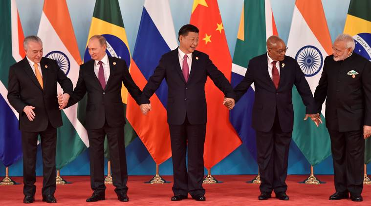 (L-R) Brazil's President Michel Temer, Russian President Vladimir Putin, Chinese President Xi Jinping, South Africa's President Jacob Zuma and Indian Prime Minister Narendra Modi prepare for a group photo during the BRICS Summit at the Xiamen International Conference and Exhibition Center in Xiamen, southeastern China's Fujian Province, China September 4, 2017. REUTERS/Kenzaburo Fukuhara/Pool